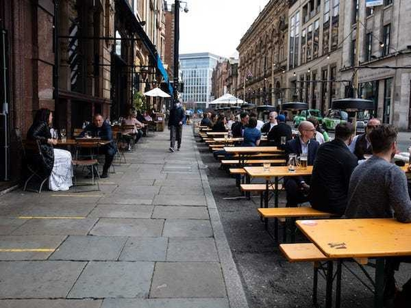 People Sitting At Trestle Tables In The Road Outside Alberts Schloss