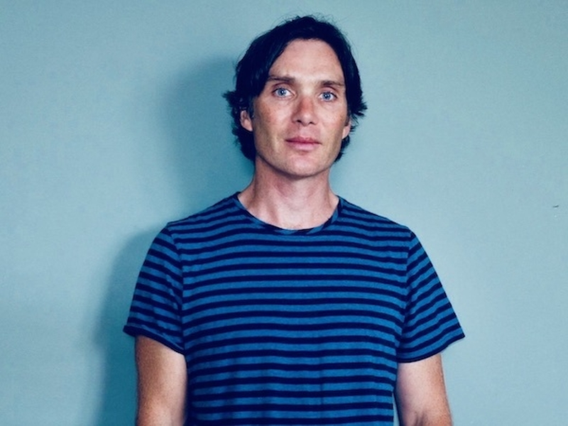 Cillian Murphy In A Striped Shirt On A Blue Background Appearing At Manchester International Festival 2021