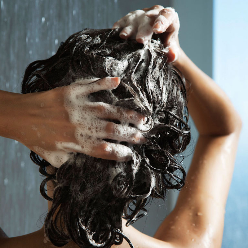 Woman Washing Her Hair With Shampoo 700