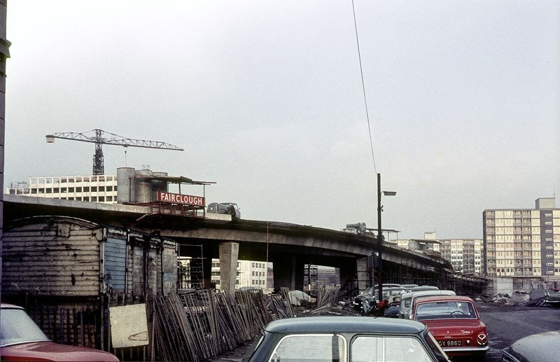 The Elevated Section Of The Mancunian Way Under Construction In 1966  The Tower Of Umists Faraday Building Also Under Construction Can Be Seen Rising Beyond The Flyover On The Left Of The Picture