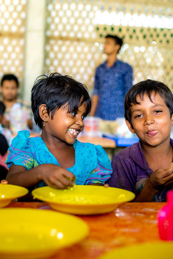 At the feeding centre in Cox's Bazar, Bangladesh, refugee children receive a hot meal.