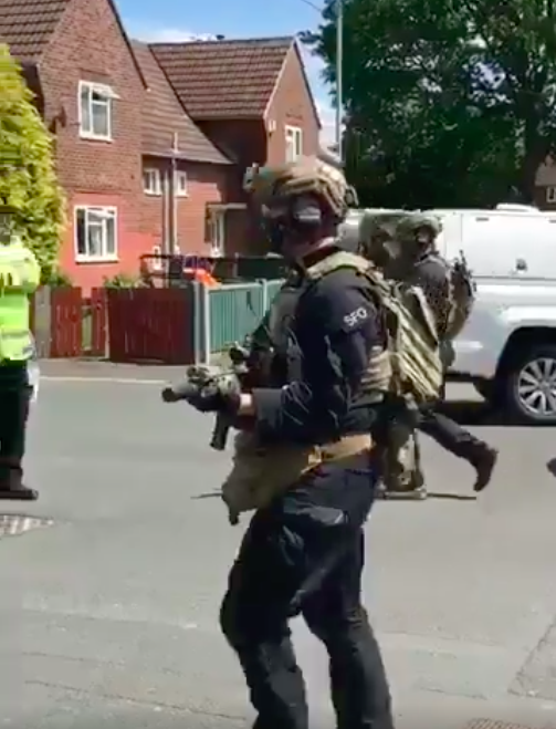 Heavily armed officers in Fallowfield