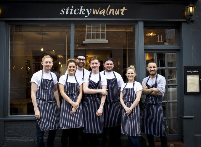 Chef Gary Usher (right) and co. outside Sticky Walnut